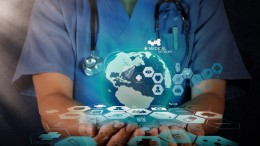 bigstock-medical-doctor-holding-a-world-49089542-s